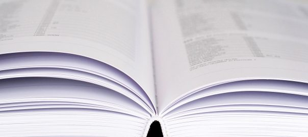 Photo of a book filled with data. Public domain image from Pixabay.com